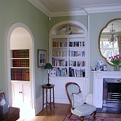 Family room with classic white painted shelving