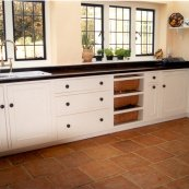 white painted oak and black granite kitchen