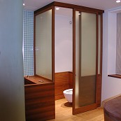 teak and glass toilet cubicle
